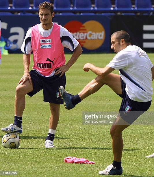 Italian forward Alessandro Del Piero practices freekicks as teammate Francesco Totti looks on during a training session 08 July 2006 in Duisburg on...