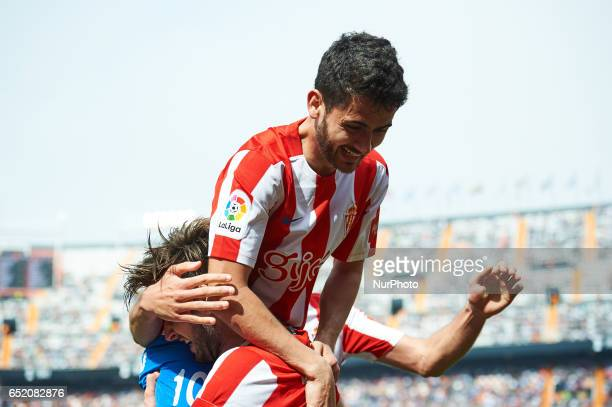 Duje Cop and Nacho Cases of Real Sporting de Gijon celebrates their goal during their La Liga match between Valencia CF and Real Sporting de Gijon at...