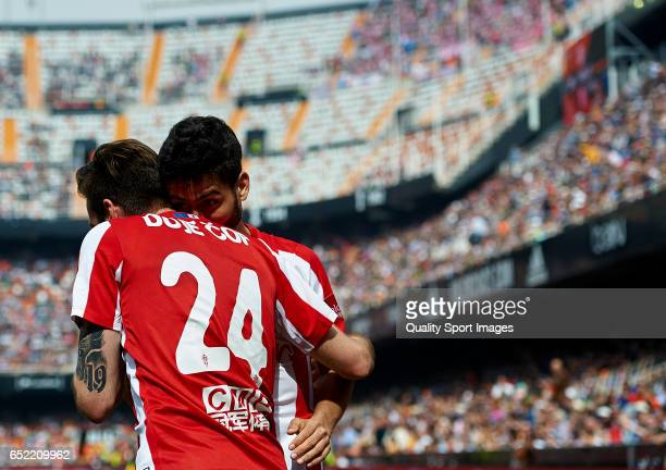 Duje Cop of Real Sporting de Gijon celebrates with his teammate after scoring a goal during the La Liga match between Valencia CF and Real Sporting...