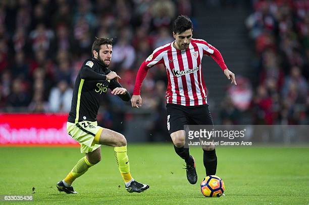 Duje Cop of Real Sporting de Gijon competes for the ball with Eneko Boveda of Athletic Club during the La Liga match between Athletic Club Bilbao and...