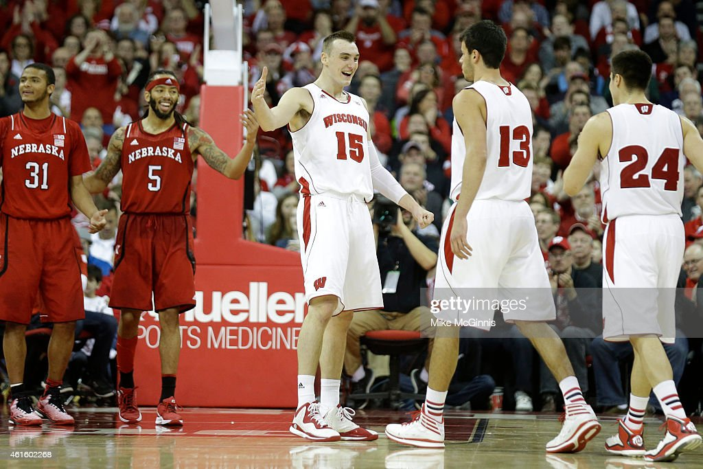Duje Dukan #13 of the Wisconsin Badgers celebrates with Sam Dekker #15after drawing the and one foul on a three pointer during the second half against the Nebraska Cornhuskers at Kohl Center on January 15, 2015 in Madison, Wisconsin.