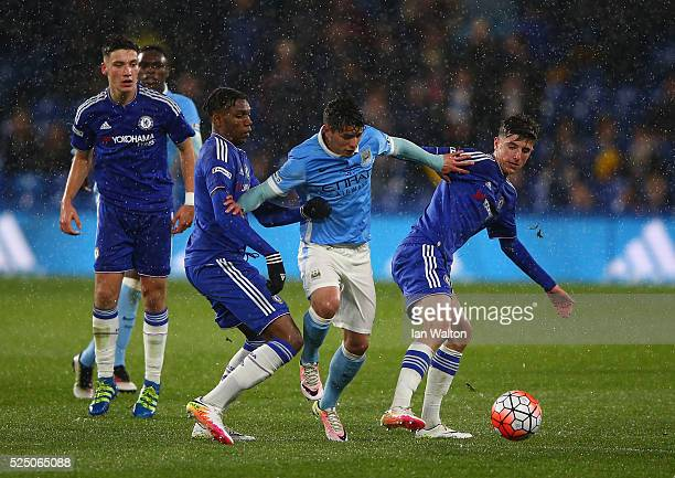 Dujon Sterling and Mason Mount of Chelsea tackle Brahim Diaz of Manchester City during the FA Youth Cup Final Second Leg match between Chelsea v...