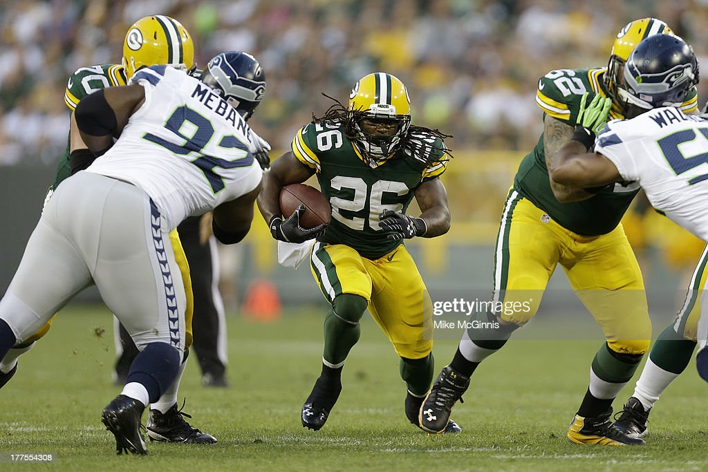 <a gi-track='captionPersonalityLinkClicked' href=/galleries/search?phrase=DuJuan+Harris&family=editorial&specificpeople=5547092 ng-click='$event.stopPropagation()'>DuJuan Harris</a> #26 of the Green Bay Packers finds a hole in the Seattle Seahawks defense during the game at Lambeau Field on August 23, 2013 in Green Bay, Wisconsin.