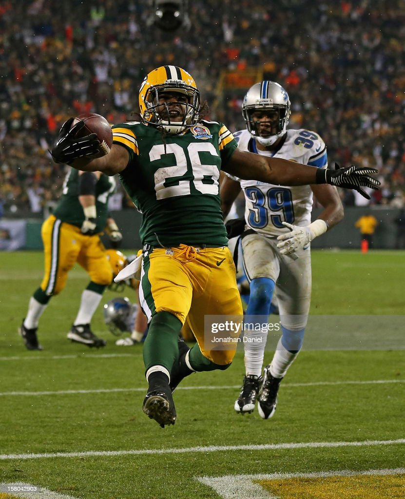 DuJuan Harris #26 of the Green Bay Packers scores a touchdown in front of Ricardo Silva #39 of the Detroit Lions at Lambeau Field on December 9, 2012 in Green Bay, Wisconsin. The Packers defeated the Lions 27-20.