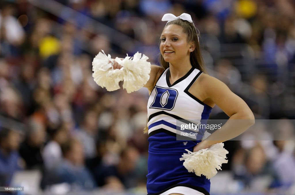 A Duke Blue Devils cheerleader performs during a break in the game against the Creighton Bluejays during the third round of the 2013 NCAA Men's Basketball Tournament at Wells Fargo Center on March 24, 2013 in Philadelphia, Pennsylvania.