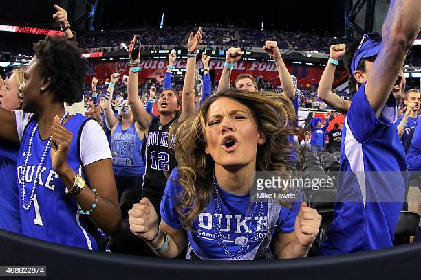 Duke Blue Devils fans cheer before taking on the Michigan State Spartans in the NCAA Men's Final Four Semifinal at Lucas Oil Stadium on April 4 2015...