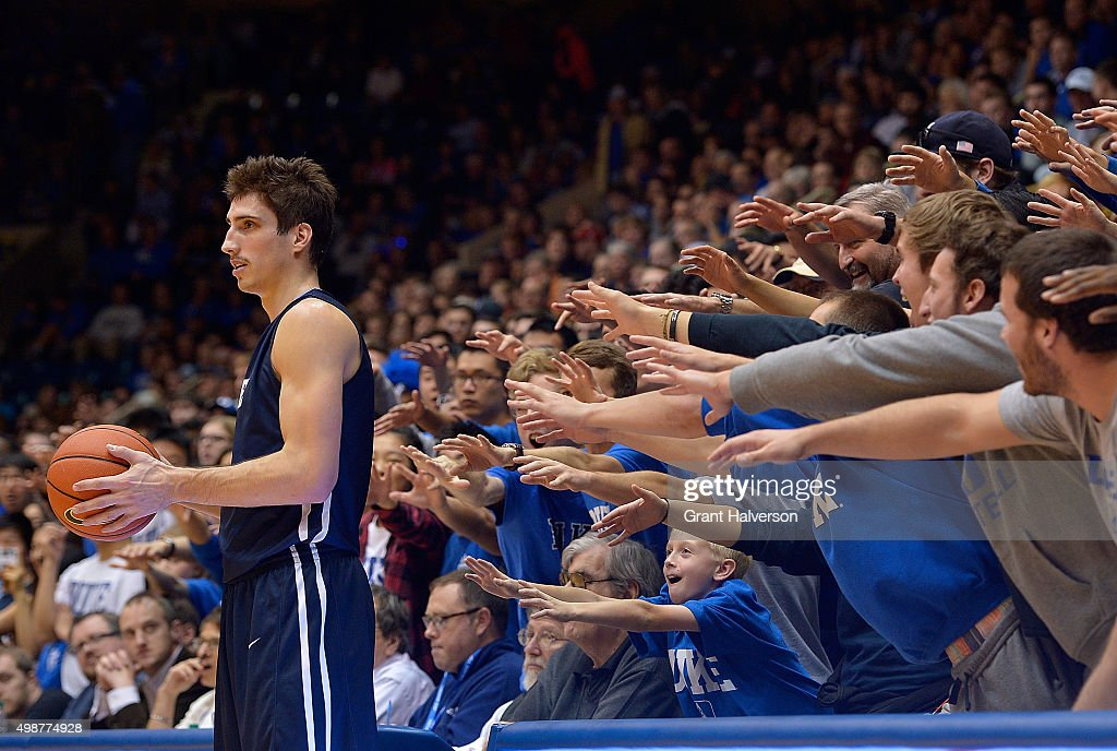 Duke Blue Devils fans taunt Nick Victor of the Yale Bulldogs as he inbounds the ball during their game at Cameron Indoor Stadium on November 25 2015...