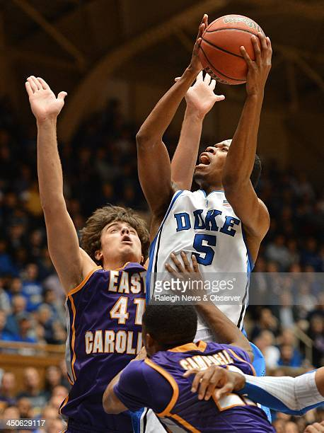 Duke Blue Devils forward Rodney Hood attacks the basket against East Carolina Pirates forward Marshall Guilmette and Pirates guard Paris...