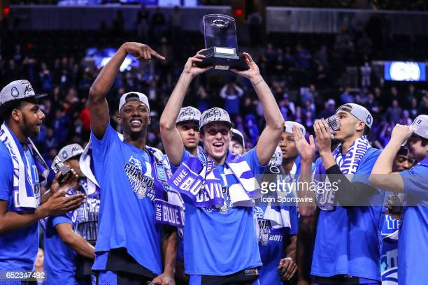 Duke Blue Devils guard Luke Kennard holds up the MVP Trophy after winning the 2017 New York Life ACC Tournament Final round game between the Notre...