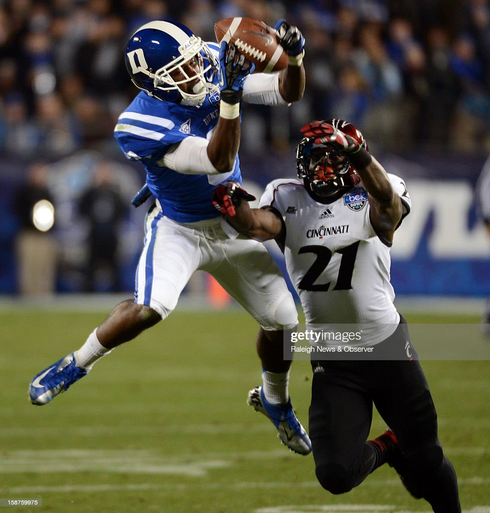 Duke Blue Devils wide receiver Jamison Crowder (3) reels in a first half pass over Cincinnati Bearcats defensive back Camerron Cheatham (21) during the Belk Bowl at Bank of America Stadium in Charlotte, North Carolina on Thursday, December 27, 2012.