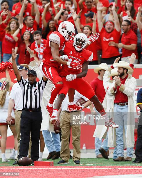 Duke Catalon of the Houston Cougars celebrates with Linell Bonner after a touchdown at TDECU Stadium on November 27 2015 in Houston Texas