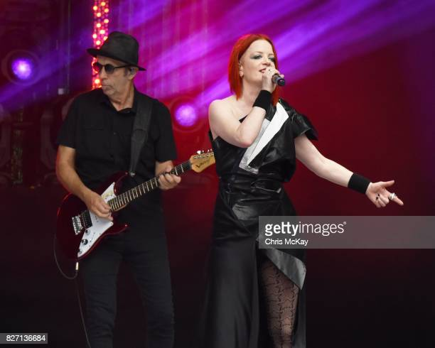 Duke Erikson and Shirley Manson of Garbage perform at Chastain Park Amphitheater on August 6 2017 in Atlanta Georgia