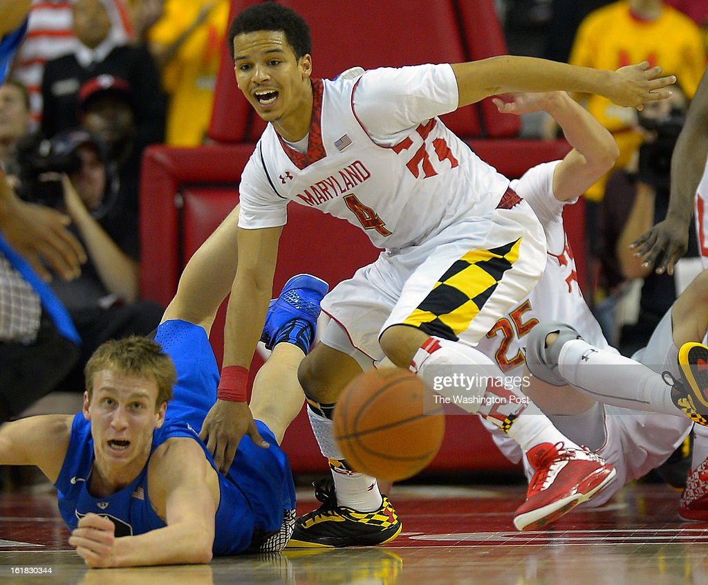 Duke forward Alex Murphy (12), left, losses the ball as Maryland guard Seth Allen (4) give chase as the University of Maryland defeats Duke 83 - 81in NCAA mens basketball at the Comcast Center in College Park MD, February 16, 2012 .