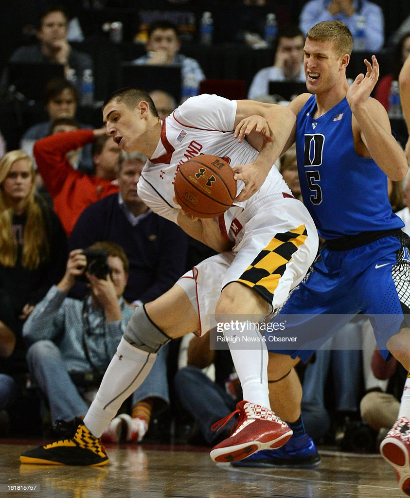 Duke forward Mason Plumlee (5) gets tangled up with Maryland center Alex Len (25) and is called for a foul in the second half at the Comcast Center in College Park, Maryland, Saturday, January 16, 2013. Maryland upset Duke, 83-81.
