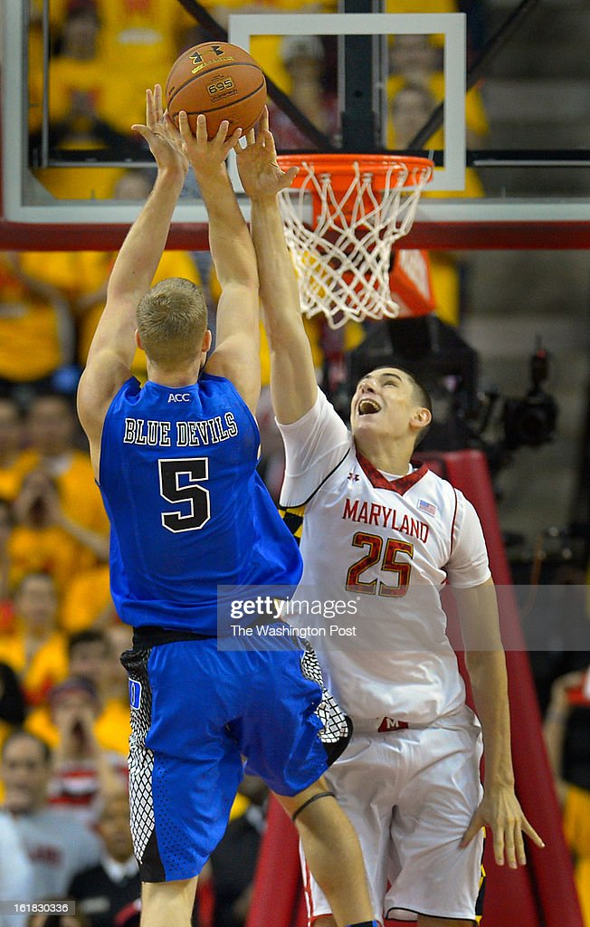 Duke forward Mason Plumlee (5), left, has his 2nd half shot blocked by Maryland center Alex Len (25) during the University of Maryland's defeat of Duke 83 - 81in NCAA mens basketball at the Comcast Center in College Park MD, February 16, 2012 .