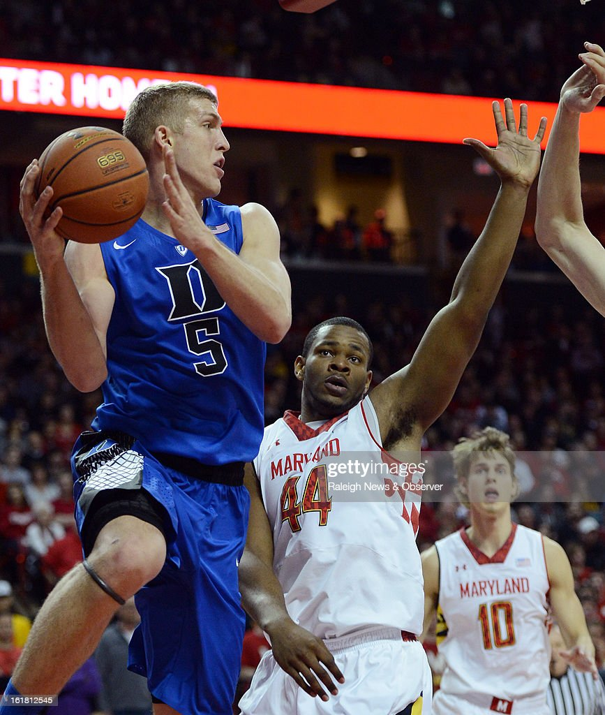 Duke forward Mason Plumlee (5) looks for help as he gets caught under the basket by Maryland center Shaquille Cleare (44) in the first half at the Comcast Center in College Park, Maryland, Saturday, February 16, 2013.