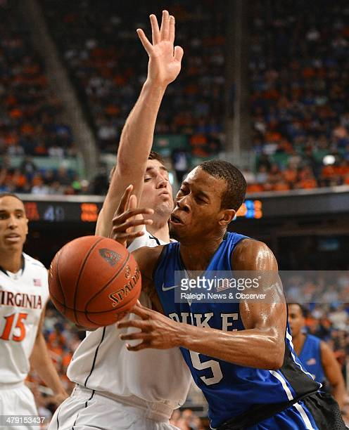 Duke forward Rodney Hood loses control of the ball in the second half as Virginia guard Joe Harris defends at Greensboro Coliseum in Greensboro NC on...