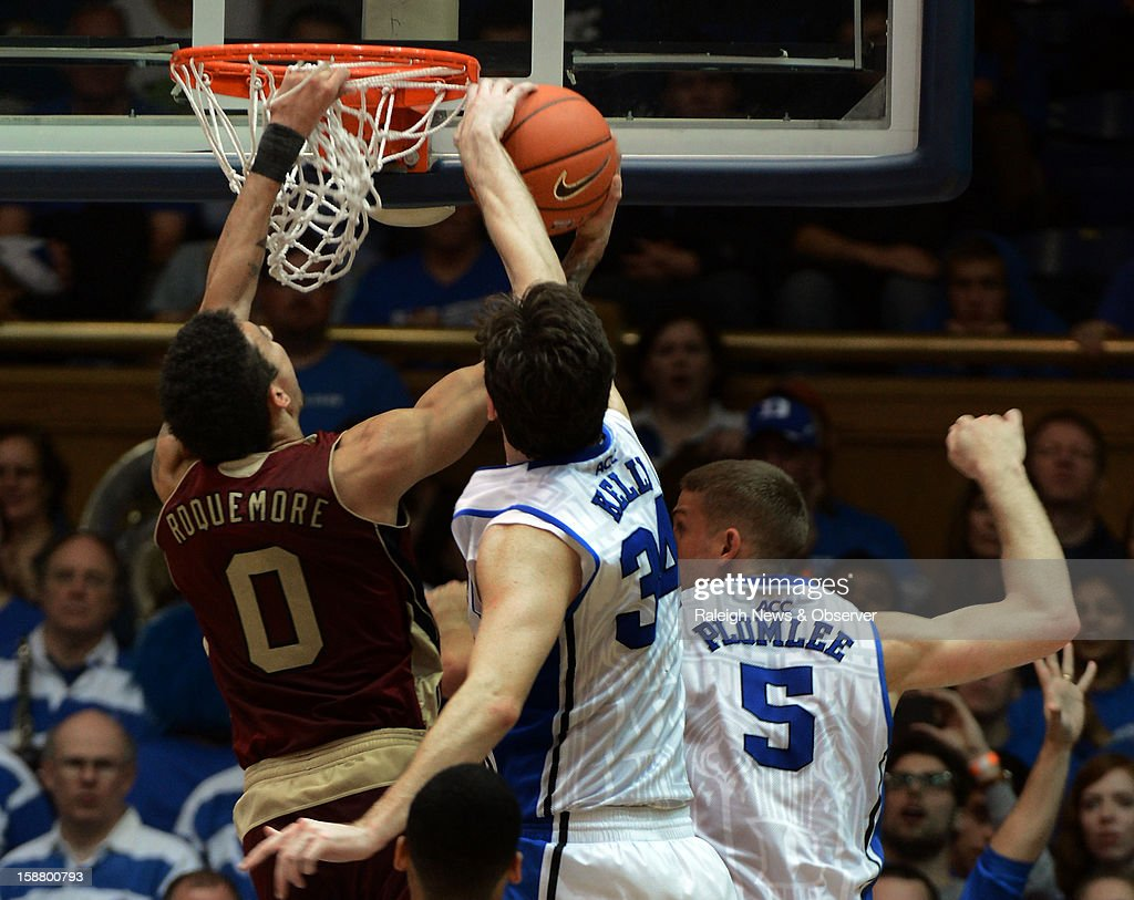 Duke forward Ryan Kelly (34) blocks a shot by Santa Clara guard Evan Roquemore (0) in the second half at Cameron Indoor Stadium in Durham, North Carolina, Saturday, December 29, 2012. Duke beat Santa Clara, 90-77.