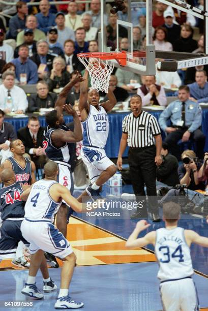 Duke guard Jason Williams crashes the board as Arizona forward Michael Wright trys to block the shot late in the second half of the NCAA Men's...