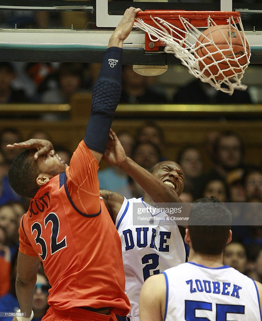 Duke guard Nolan Smith fouls Virginia forward Mike Scott as he jams home a dunk in the first half at Cameron Indoor Stadium in Durham North Carolina