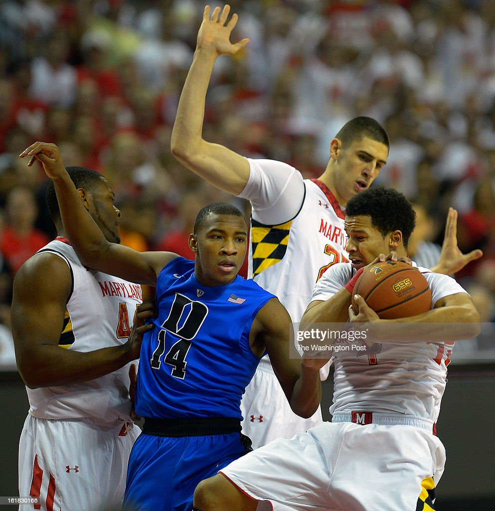 Duke guard Rasheed Sulaimon (14), center left, falls away from Maryland guard Seth Allen (4), right, grabbing a rebound asDuke plays the University of Maryland in NCAA mens basketball at the Comcast Center in College Park MD, February 16, 2012 .