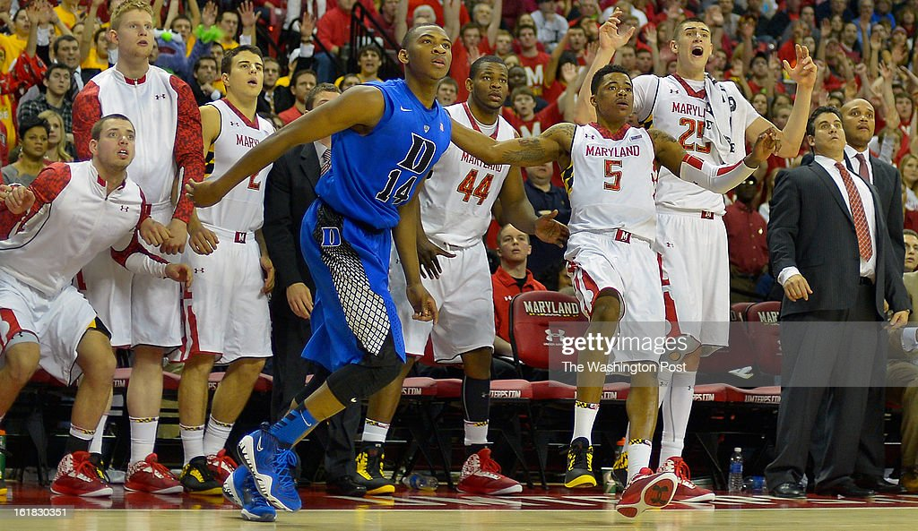 Duke guard Rasheed Sulaimon (14), center, watches Maryland guard Nick Faust (5), center right, late 2nd half 3 point shot miss as the Maryland bench reacts as the University of Maryland defeats Duke 83 - 81in NCAA mens basketball at the Comcast Center in College Park MD, February 16, 2012 .