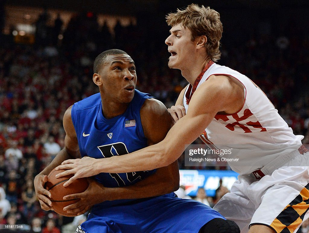 Duke guard Rasheed Sulaimon (14) is fouled by Maryland forward Jake Layman (10) in the second half at the Comcast Center in College Park, Maryland, Saturday, February 16, 2013. Maryland beat Duke, 83-81.
