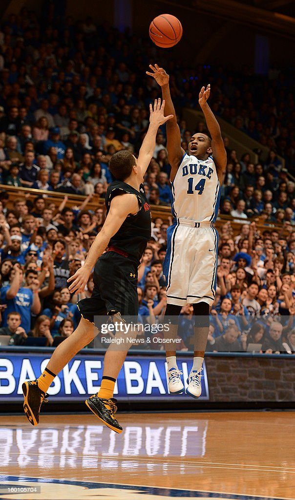 Duke guard Rasheed Sulaimon (14) shoots one of his three-pointers over Maryland forward Jake Layman (10) in the second half at Cameron Indoor Stadium in Durham, North Carolina, Saturday, January 26, 2013. Duke defeated Maryland, 84-64.