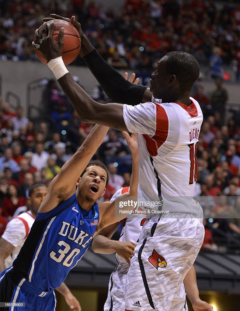 Duke guard Seth Curry (30) gets stripped of the ball by Louisville center Gorgui Dieng (10) in the second half of the NCAA Tournament at Lucas Oil Stadium in Indianapolis, Indiana, Sunday, March 31, 2013. Louisville defeated Duke, 85-63.