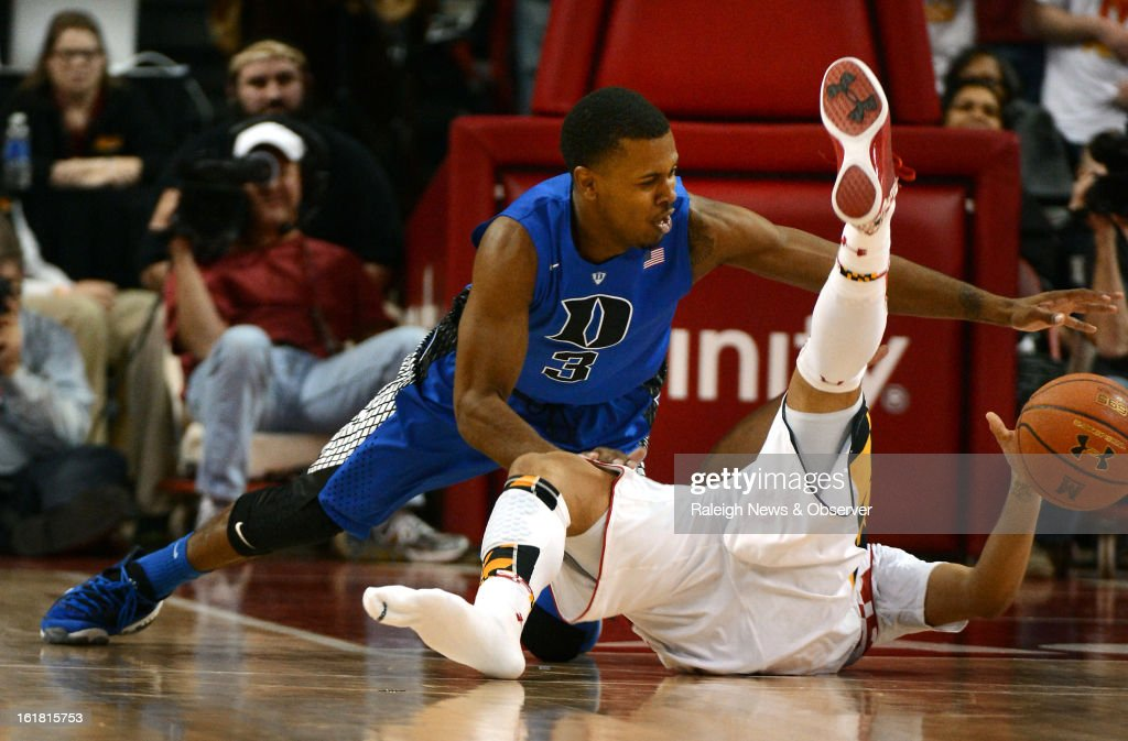 Duke guard Tyler Thornton (3) strips the ball from Maryland guard Seth Allen (4), after Allen loses his shoe and the ball, in the second half at the Comcast Center in College Park, Maryland, Saturday, January 16, 2013. Maryland upset Duke, 83-81.