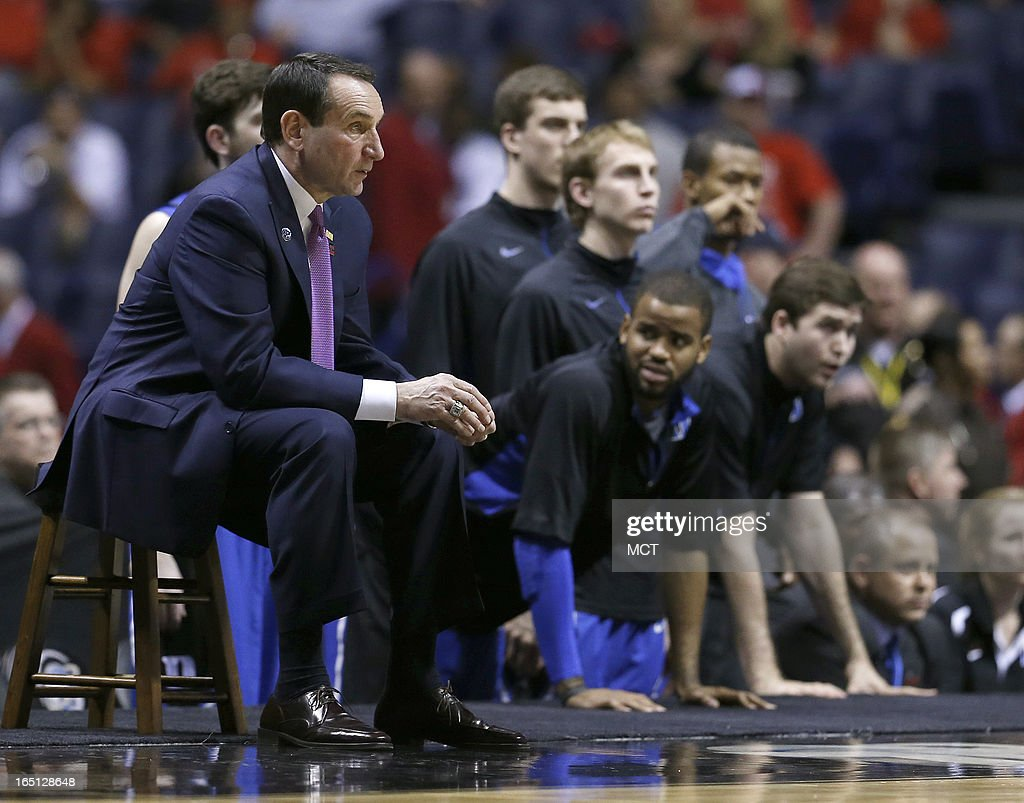 Duke head coach Mike Krzyzewski and his team watch the final seconds of the game in their loss in the NCAA regional final game on Sunday, March 31, 2013, in Indianapolis, Indiana. Louisville won the game 85-63. (Sam Riche/MCT via Getty Images)in the NCAA regional final game on Sunday, March 31, 2013, in Indianapolis, Indiana. Louisville won the game 85-63.