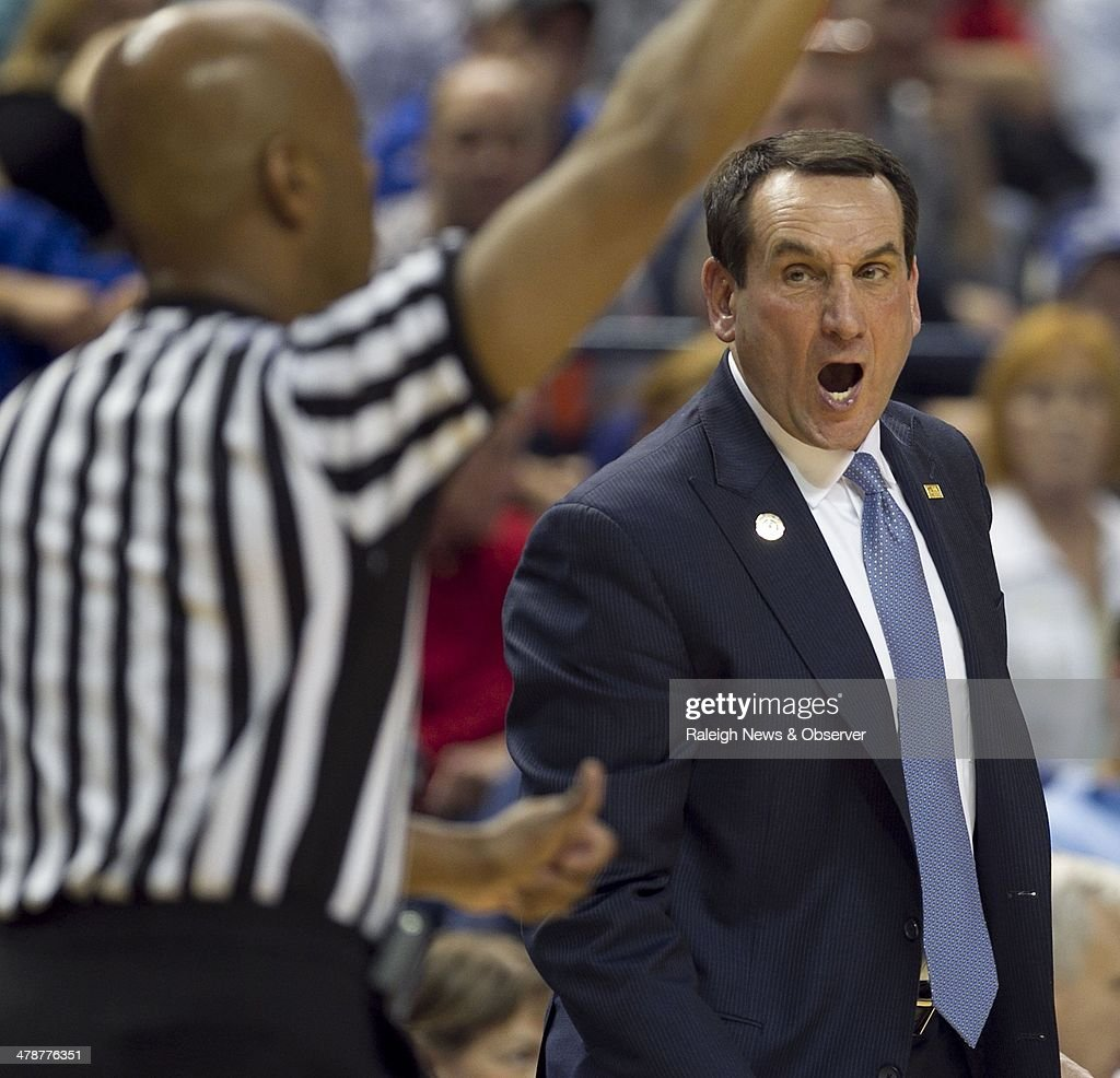 Duke head coach Mike Krzyzewski argues a call with official Sean Hull during the first half against Clemson in the ACC Tournament quarterfinals at the Greensboro Coliseum in Greensboro, N.C., Friday, March 14, 2014.