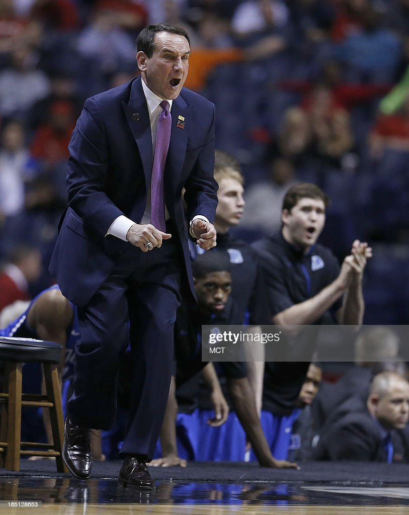 Duke head coach Mike Krzyzewski calls a play in second half action in the NCAA regional final game on Sunday, March 31, 2013, in Indianapolis, Indiana. Louisville won the game 85-63. (Sam Riche/MCT via Getty Images)in the NCAA regional final game on Sunday, March 31, 2013, in Indianapolis, Indiana. Louisville won the game 85-63.