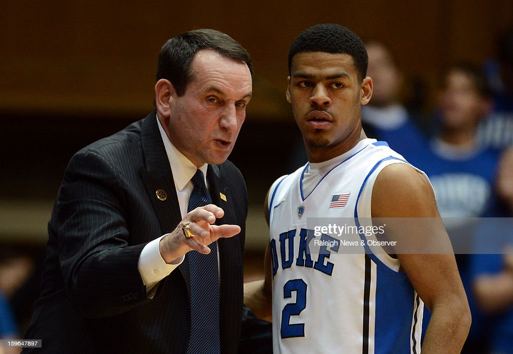 Duke head coach Mike Krzyzewski gives first-half instructions to guard Quinn Cook (2) amid action against Georgia Tech at Cameron Indoor Stadium in Durham, North Carolina, on Thursday, January 17, 2013.