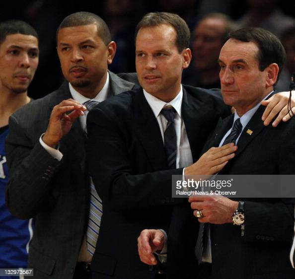 Duke head coach Mike Krzyzewski right is congratulated by assistant Chris Collins and Jeff Capel left as the buzzer sounds on a 7469 win over the...