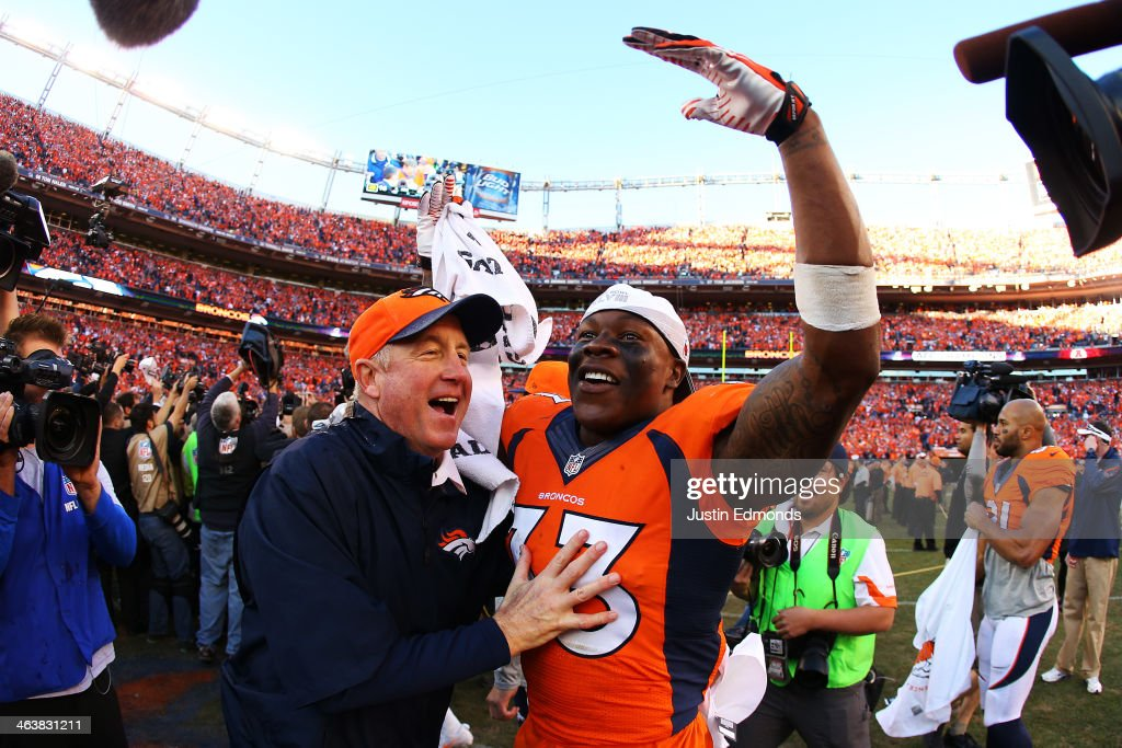 <a gi-track='captionPersonalityLinkClicked' href=/galleries/search?phrase=Duke+Ihenacho&family=editorial&specificpeople=6241776 ng-click='$event.stopPropagation()'>Duke Ihenacho</a> #33 of the Denver Broncos celebrates with head coach <a gi-track='captionPersonalityLinkClicked' href=/galleries/search?phrase=John+Fox+-+Trainer&family=editorial&specificpeople=206657 ng-click='$event.stopPropagation()'>John Fox</a> after they defeated the New England Patriots 26 to 16 during the AFC Championship game at Sports Authority Field at Mile High on January 19, 2014 in Denver, Colorado.