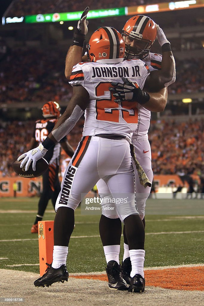 c83f261a8 Duke Johnson Jr. 29 of the Cleveland Browns is congratulated by John John  Greco Nike Cleveland Browns Limited Green Salute to Service Tank Top Jersey  ...