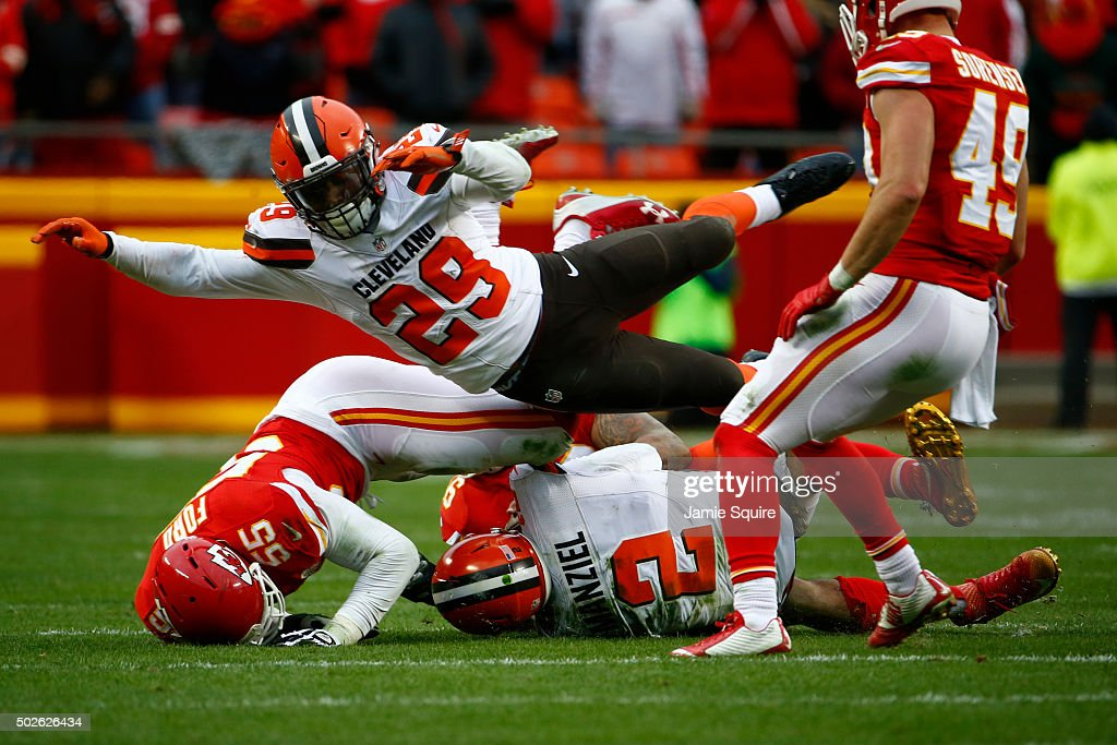 Duke Johnson #29 of the Cleveland Browns dives over the teammate Johnny Manziel while he is being tackled by Dee Ford #55 of the Kansas City Chiefsat Arrowhead Stadium during the fourth quarter of the game on December 27, 2015 in Kansas City, Missouri.
