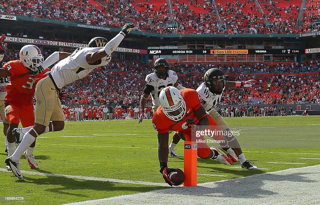 Duke Johnson of the Miami Hurricanes dives for the pylon during a game against the Wake Forest Demon Deacons at Sun Life Stadium on October 26 2013...