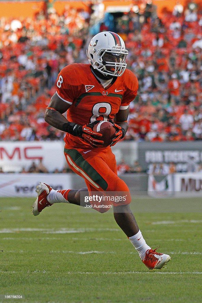 Duke Johnson #8 of the Miami Hurricanes runs with the ball against the South Florida Bulls on November 17, 2012 at Sun Life Stadium in Miami Gardens, Florida. The Hurricanes defeated the Bulls 40-9.