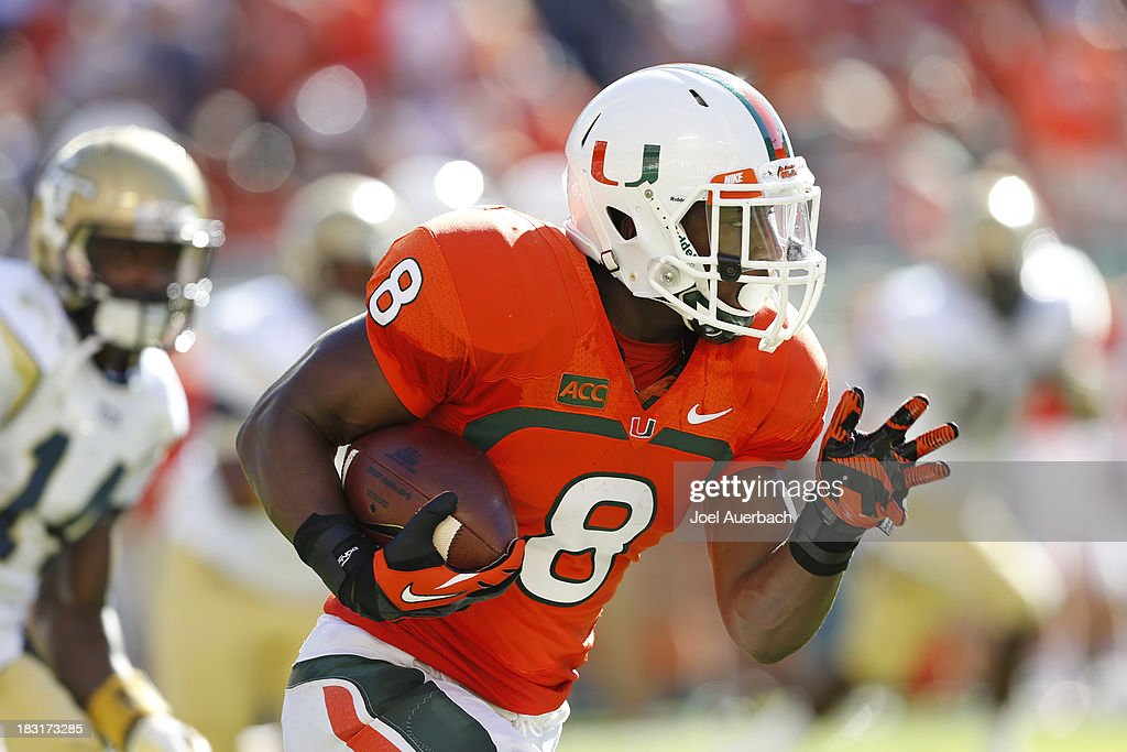 <a gi-track='captionPersonalityLinkClicked' href=/galleries/search?phrase=Duke+Johnson+-+American+Football+Player&family=editorial&specificpeople=13981151 ng-click='$event.stopPropagation()'>Duke Johnson</a> #8 of the Miami Hurricanes runs with the ball against the Georgia Tech Yellow Jackets on October 5, 2013 at Sun Life Stadium in Miami Gardens, Florida.