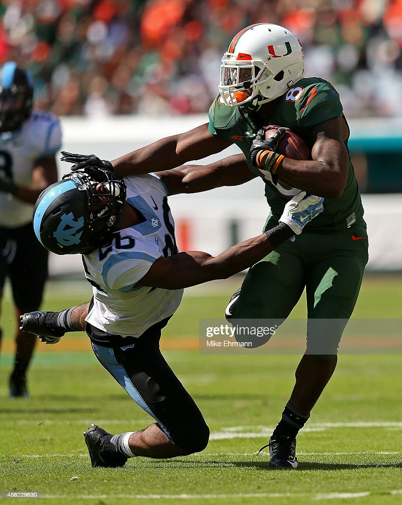 Duke Johnson #8 of the Miami Hurricanes rushes for a first down during a game against the North Carolina Tar Heels at Sun Life Stadium on November 1, 2014 in Miami Gardens, Florida.