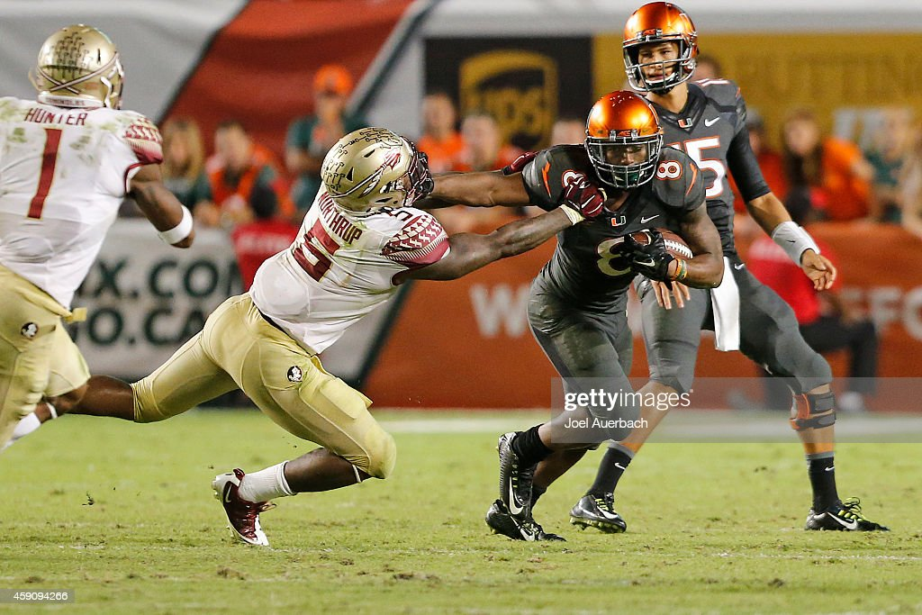 <a gi-track='captionPersonalityLinkClicked' href=/galleries/search?phrase=Duke+Johnson+-+American+football-speler&family=editorial&specificpeople=13981151 ng-click='$event.stopPropagation()'>Duke Johnson</a> #8 of the Miami Hurricanes stiff arms Reggie Northrup #5 of the Florida State Seminoles as he runs with the ball on November 15, 2014 at Sun Life Stadium in Miami Gardens, Florida. The Seminoles defeated the Hurricanes 30-26.
