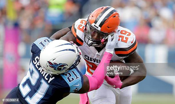 Duke Johnson Sr #29 of the Cleveland Browns has his facemask pulled by Da'Norris Searcy of the Tennessee Titans during the game at Nissan Stadium on...