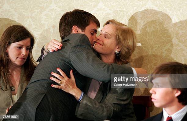 Duke lacrosse player David Evans hugs his mother Rae Evans during a news conference at the Sheraton Raleigh Hotel after being cleared of sexual...