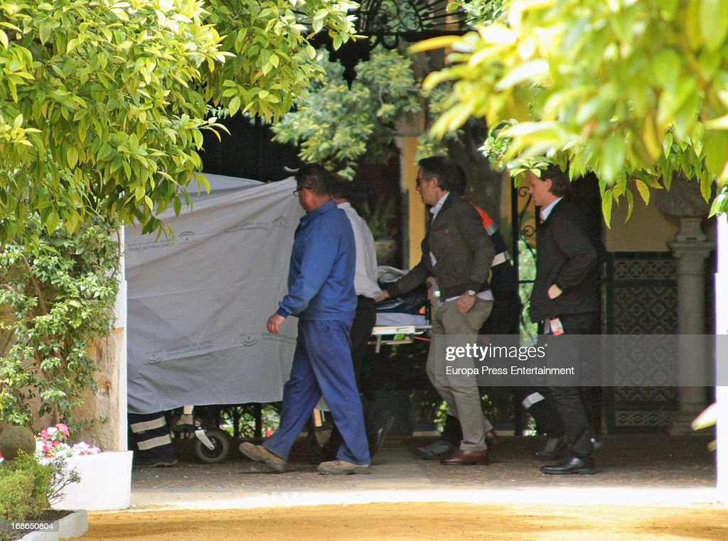 Duke of Alba Alfonso Diez (C) is seen next to the stretcher where Duchess of Alba Cayetana Fitz James Stuart lies downon April 30, 2013 in Seville, Spain.