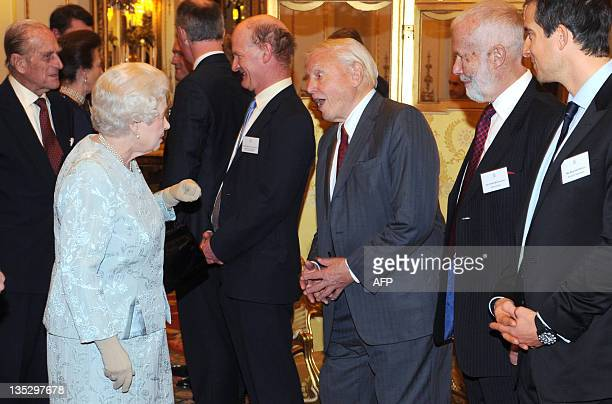 Duke of Edinburgh stand as Britain's Queen Elizabeth II speaks with naturist David Attenborough as Chief Scout Bear Grylls and mountaineer Chris...
