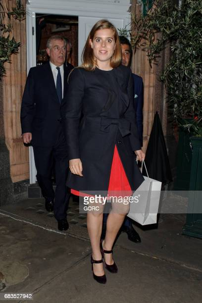 Duke of York Prince Andrew and Princess Beatrice leaving Harry's Bar on May 15 2017 in London England