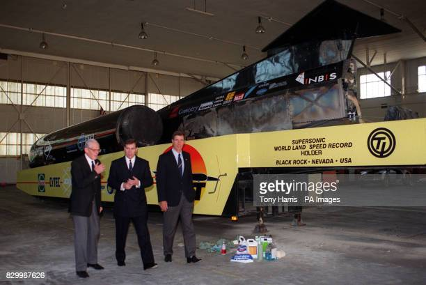 Duke of York talks to Squadron leader Andy Green and Thurst's aerodynamicist Ron Ayers during a visit to Farnborough Hants today The Duke spent more...