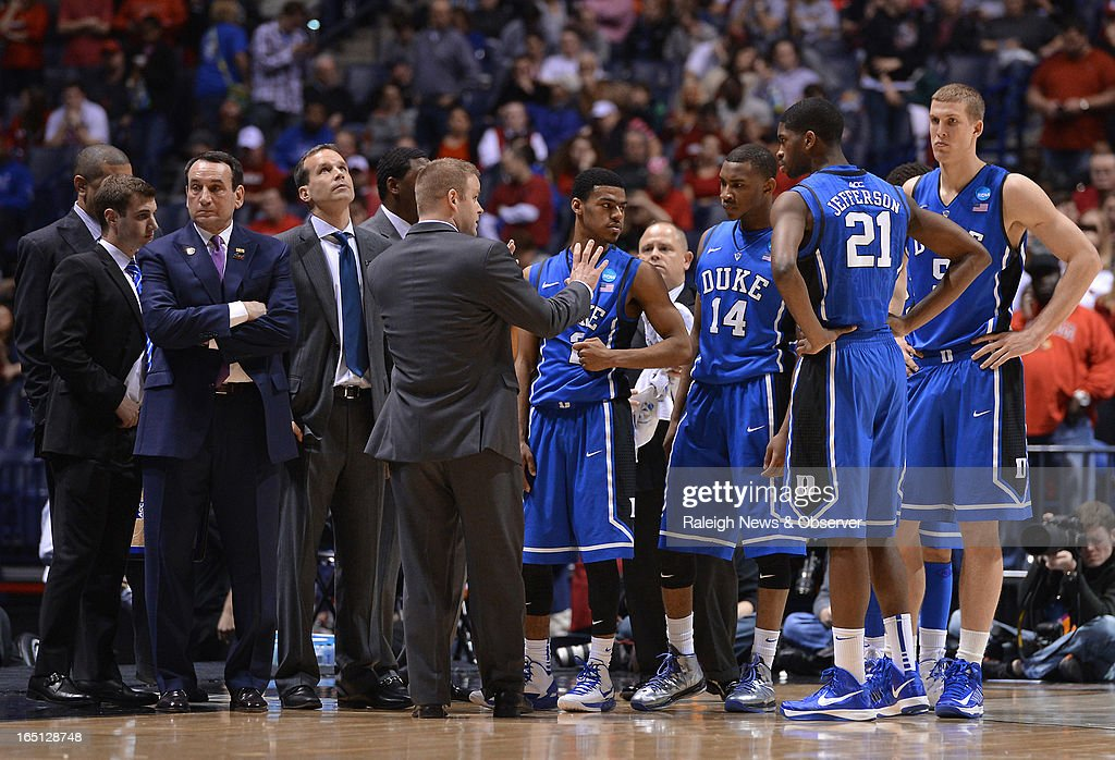 Duke players and coaches gather after Louisville Cardinals guard Kevin Ware (5) broke his leg in the first half of the NCAA Tournament at Lucas Oil Stadium in Indianapolis, Indiana, Sunday, March 31, 2013. Louisville defeated Duke, 85-63.